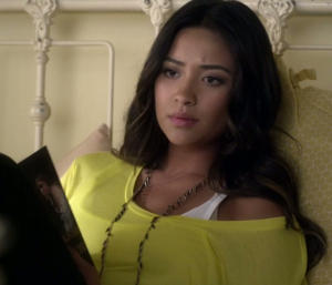 "The character of Emily Fields from ABC's Pretty Little Liars, holds an early copy of ""The Pirate's Daughter And A King's Ransom""."